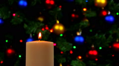 White candle with blinking lights in background Stock Footage