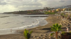 People on sunset beach, Playa de las Americas, Tenerife, Canary islands. Stock Footage