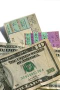 ticket stubs and cash - stock photo