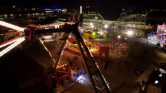 Aerial - Big hammer in a swing at amusement park at night Stock Footage