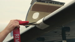 Pilot Attaches Post-Flight Safety Covers Ribbons to Wing Stock Footage