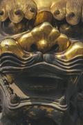 Ancient traditional chinese decorative detail of brass lion Stock Photos
