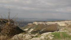 View from Mangup plateau of the mountain scenery in Crimea pan shot Stock Footage