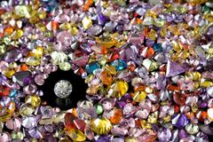 Solitaire Diamond Surrounded By Colorful Gems Stock Photos