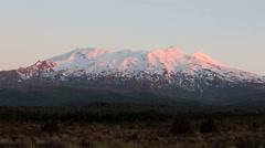 Sun setting on a snow covered Mount Ruapehu Stock Footage