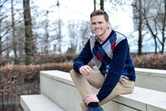 Stock Photo of Stylish young man posing casualy
