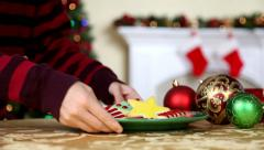 Boy Leaving Cookies For Santa Stock Footage