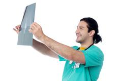 Stock Photo of Cheerful male doctor with x-ray