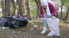 Local residents cleaning park from garbage after holiday weekend Stock Footage