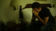 Sad thinking hotel room Stock Footage