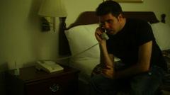 Talking on phone hotel room Stock Footage