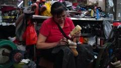 Shenzhen, China: shoe repair stall Stock Footage