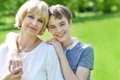 Stock Photo of Pretty mother with her charming son