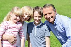 Lovable family enjoying sunny day outdoors - stock photo