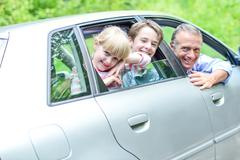 Father out on a long drive with kids Stock Photos