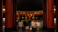 Time-lapse front view of people visiting Senso-ji temple, Tokyo, Japan Stock Footage