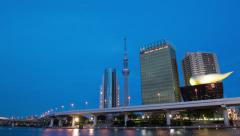 Time-lapse day-to-night pan up view of Tokyo Skytree and Asahi Building from - stock footage