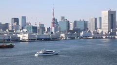 Boats cruising at Tokyo Bay and view of Tokyo cityscape from Rainbow Bridge, Stock Footage