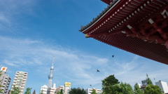 Time-lapse low angle view of Tokyo Skytree from Senso-ji temple, Tokyo, Japan Stock Footage