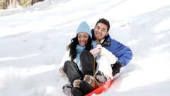 Couple Snow Sledding Stock Footage