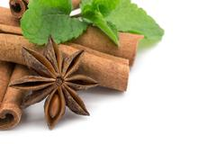 Cloves, anise and cinnamon isolated on white background Stock Photos
