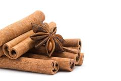 Anice and cinnamon on white Stock Photos