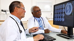 Doctors Reviewing Test Result Stock Footage