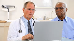 Doctor And Patient Reviewing Test Result Stock Footage