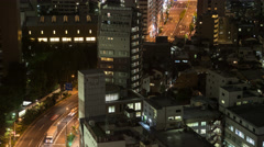 Time Lapse Pan Down Night View Of City Buildings And Traffic, Tokyo, Japan - stock footage