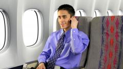 Businessman On Airplane Using Cell Phone - stock footage
