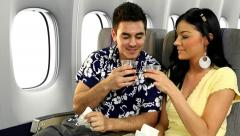 Couple Traveling On Airplane Stock Footage