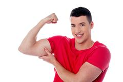 Fitness man showing bicep muscles Stock Photos