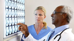Doctor And Nurse Reviewing Test Result - stock footage