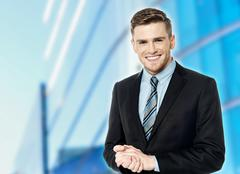Corporate guy posing with clasped hands Stock Photos