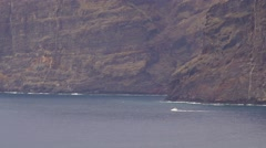 Boat sailing by giant rocks, Los Gigantes, Tenerife, Canary islands. Stock Footage