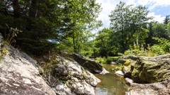 Creek shot with slider from rock to rock Stock Footage