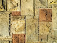 Stock Photo of stone wall background, regular shape wallpaper.