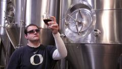1287 - brewmaster samples the brew Stock Footage