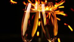 Two glasses with wine and sparkler Stock Footage