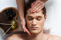 Masseuse doing facial massage Kuvituskuvat