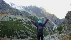 Successful woman raising hands in the mountains, Tatras, Slovakia HD Stock Footage