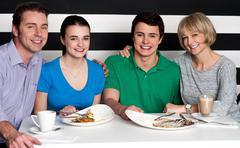 Family enjoying dinner at a restaurant - stock photo
