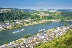 Cruise ship passes st. goarshausen on the river rhine, rhine gorge, unesco wo Stock Photos