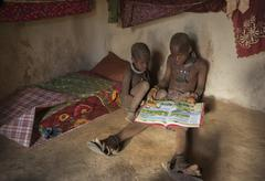 Himba children reading, kaokoland, namibia, africa Stock Photos