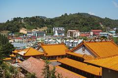 view of brinchang town and chinese temple, cameron highlands, pahang, malaysi - stock photo