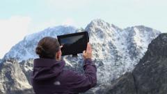 Woman hiker taking photo with digital tablet, Tatras, Slovakia HD Stock Footage
