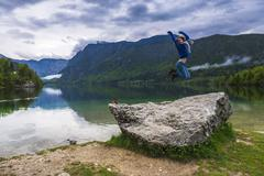 tourist visiting lake bohinj, triglav national park, julian alps, slovenia, e - stock photo