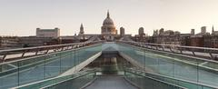 millennium bridge and st. paul's cathedral at sunrise, london, england, unite - stock photo