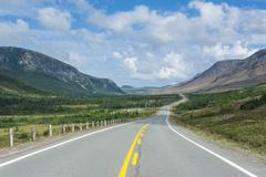 straight bonne bay road on the east arm of gros morne national park, unesco w - stock photo