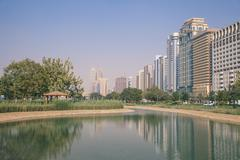 City center buildings reflecting in corniche lake, abu dhabi, united arab emi Stock Photos